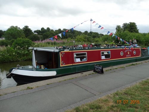 Boat selling canal ware. Jugs and pots all painted with roses in traditional style.