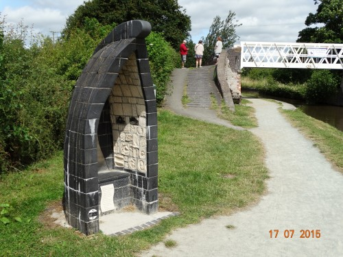 Ellesmere arm. There are many sculptures around the canal and town, and this is in the entrance to the arm.