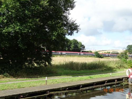Railway running alongside the canal in places. Virgin trains going much faster than us!