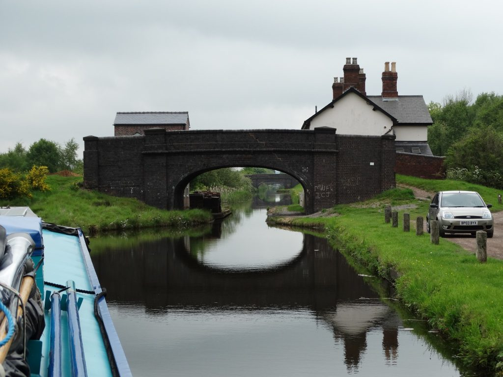 And on to the Cannock extension canal. On the left above the bridge is an oold stable block that was for boat horses in the day, but now being developed as a des res. On the right 2 old cottages.