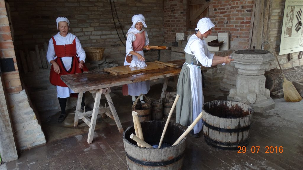 doing the washing Tudor style. Apparently they used 2 week old urine to get stains out of the clothes...nice!