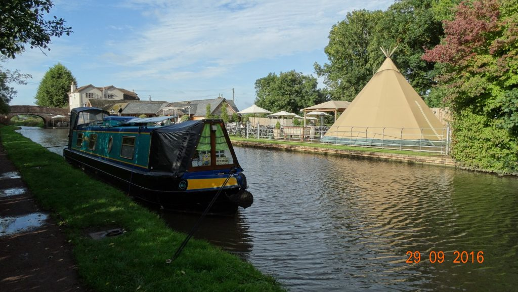 moored opposite the Queens head with teepee in view