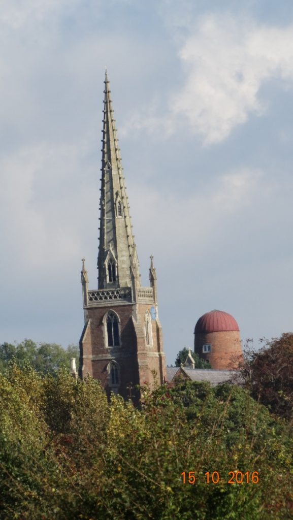 Braunston church with remains of a former windmill in view